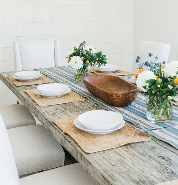 Italian home design dining room limestone wall San Diego Homes of the Year 2019