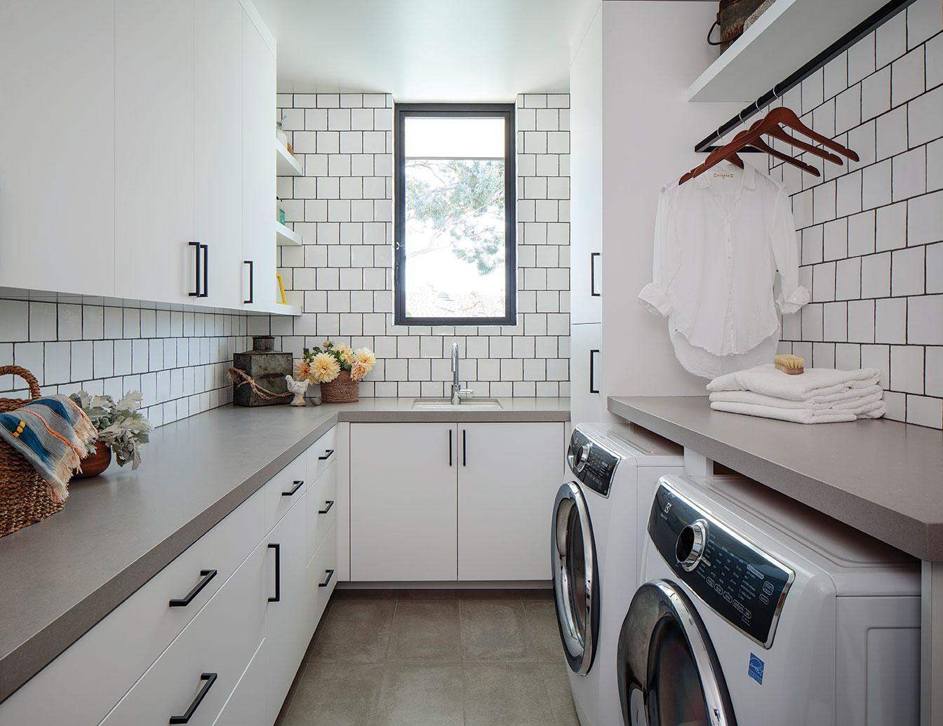 laundry room white tile neutral color design san diego