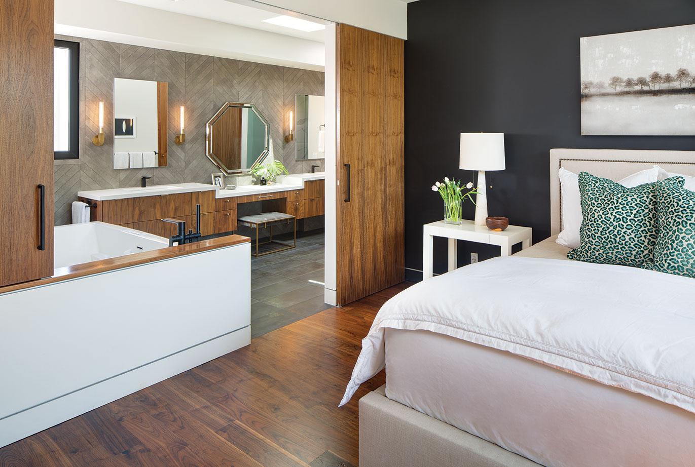 modern family home master bedroom bathroom black paint walls walnut trim soaking tub