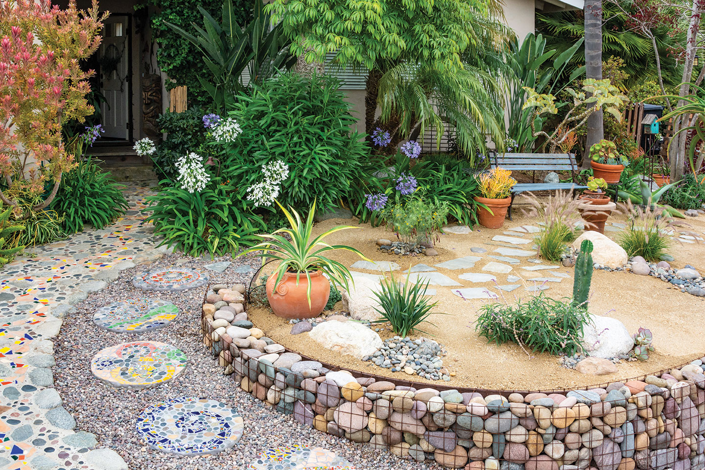 mosaic stepping stones recycled and upcycled in a gravel walkway in a san diego front garden