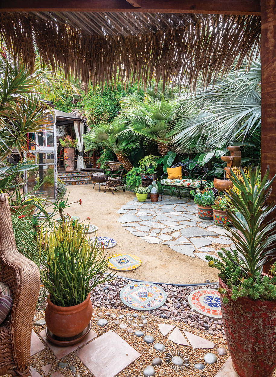 palapa deck thatched roof with mosaic pavers stepping stones, pea gravel and flagstone tiles in a secluded san diego garden