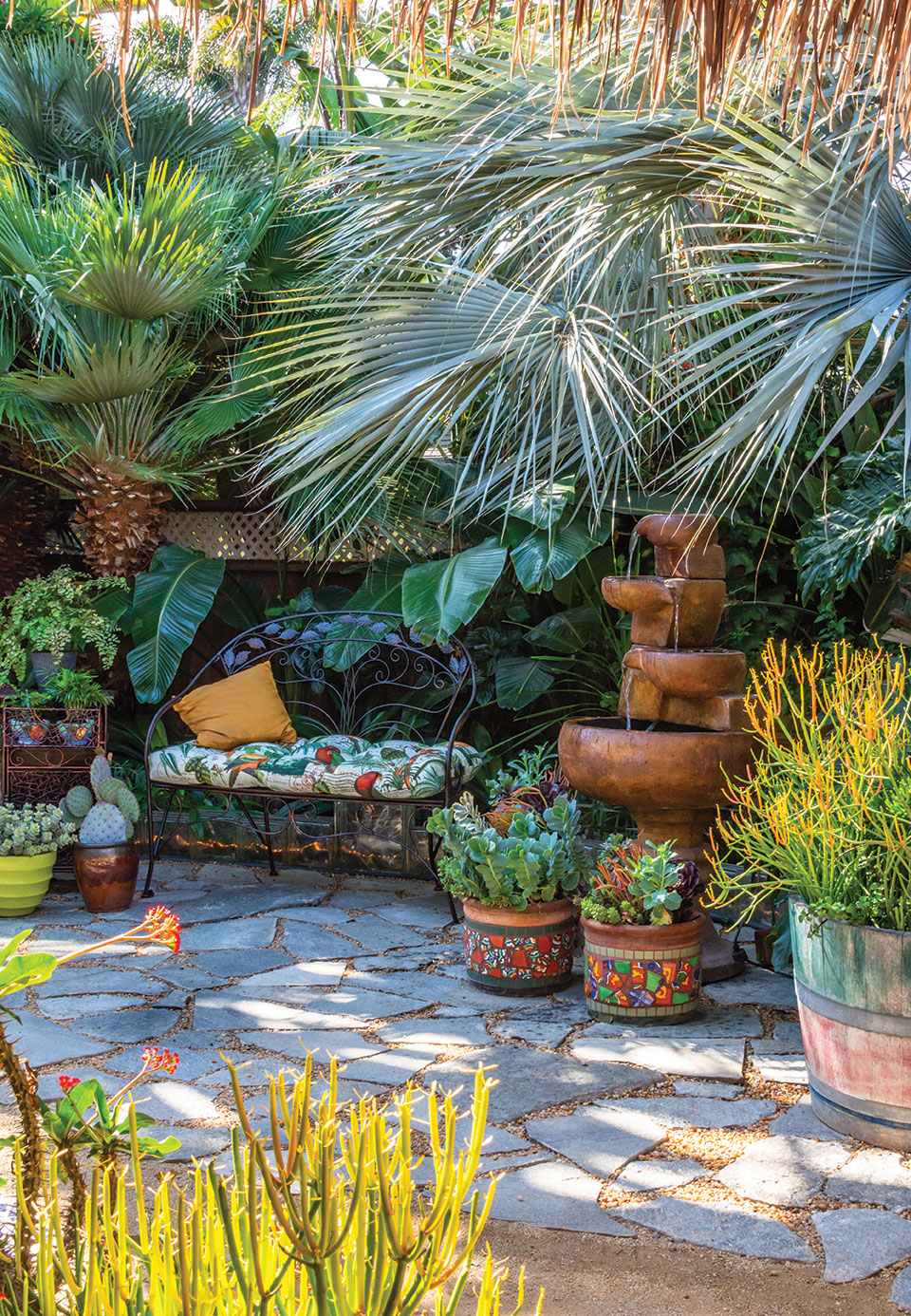 flagstone paver remnants mosaic pots and a bench in an artful and changeable san diego garden