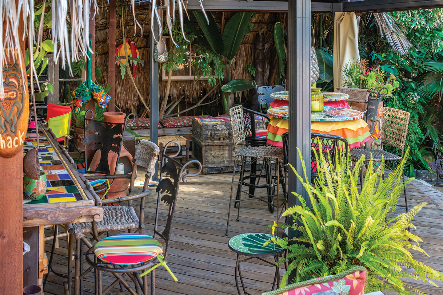 wrought iron chairs bright colors and patio deck furniture in a custom changeable garden in san diego