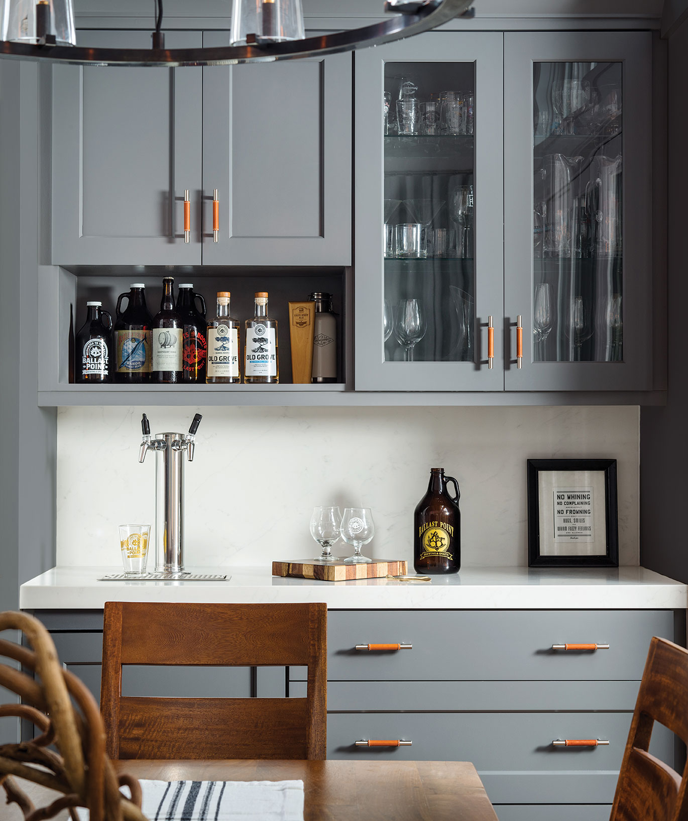 bar area in dining space with built-in taps kegerator