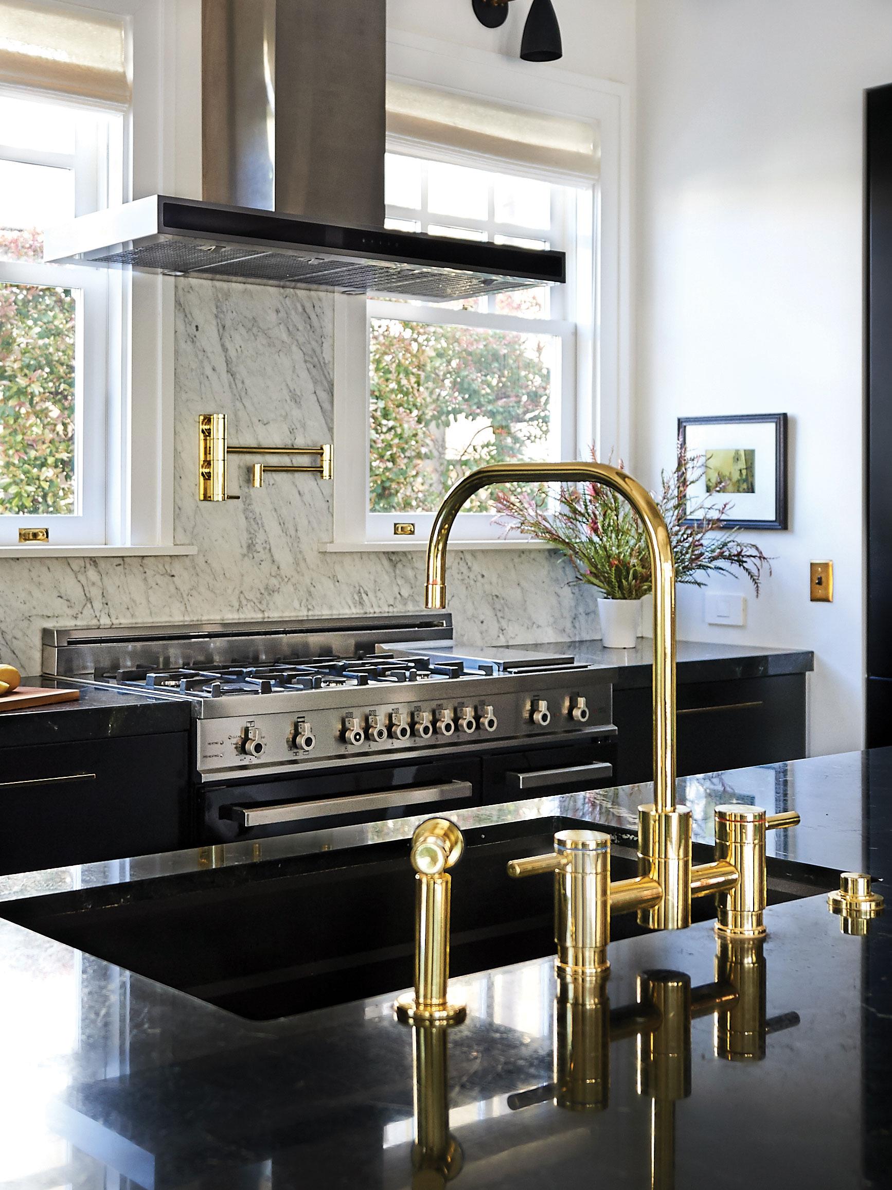 brass marble black kitchen