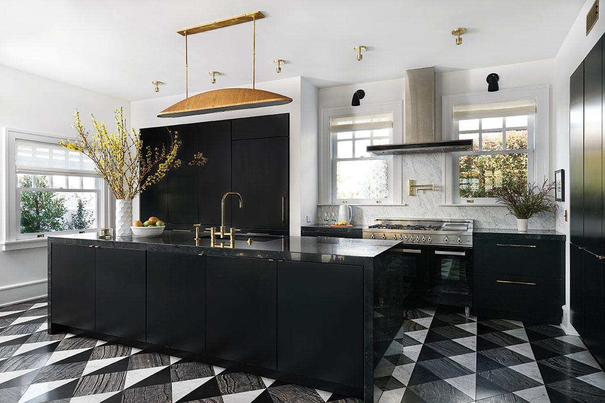 black kitchen black and white floor tile brass hardware marble backsplash