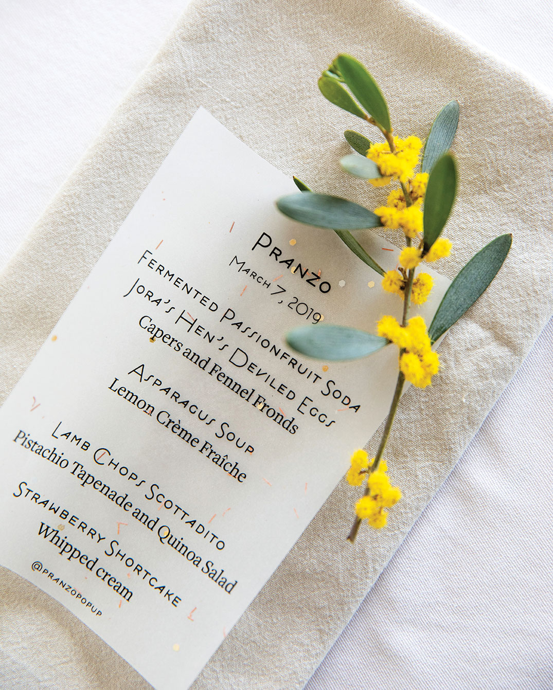 pranzo popup pop-up lunch luncheon printed menu on napkin with yellow flower garnish