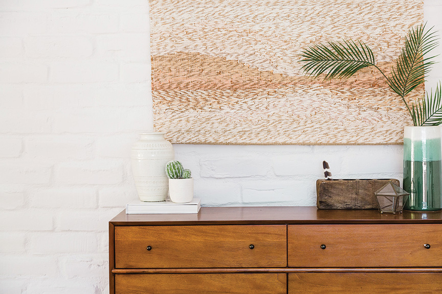 southwest style desert style dresser credenza with desert decor and art