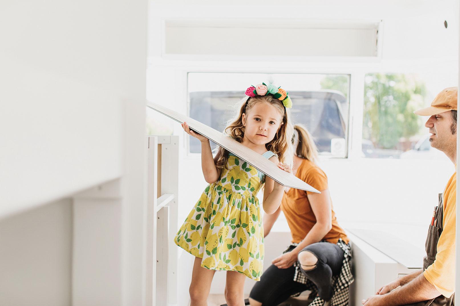 flooring installation vintage Argosy trailer remodel with kids