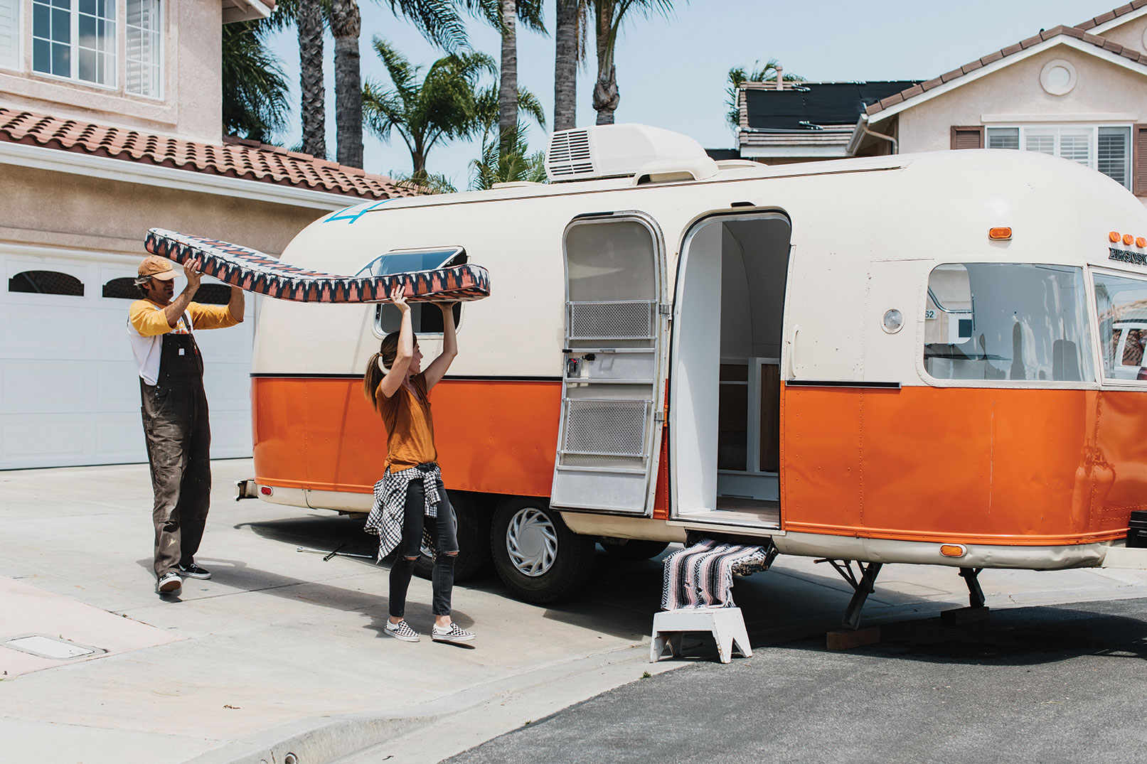 vintage Argosy trailer remodel san diego nomadic living installing a patterned bench cushion