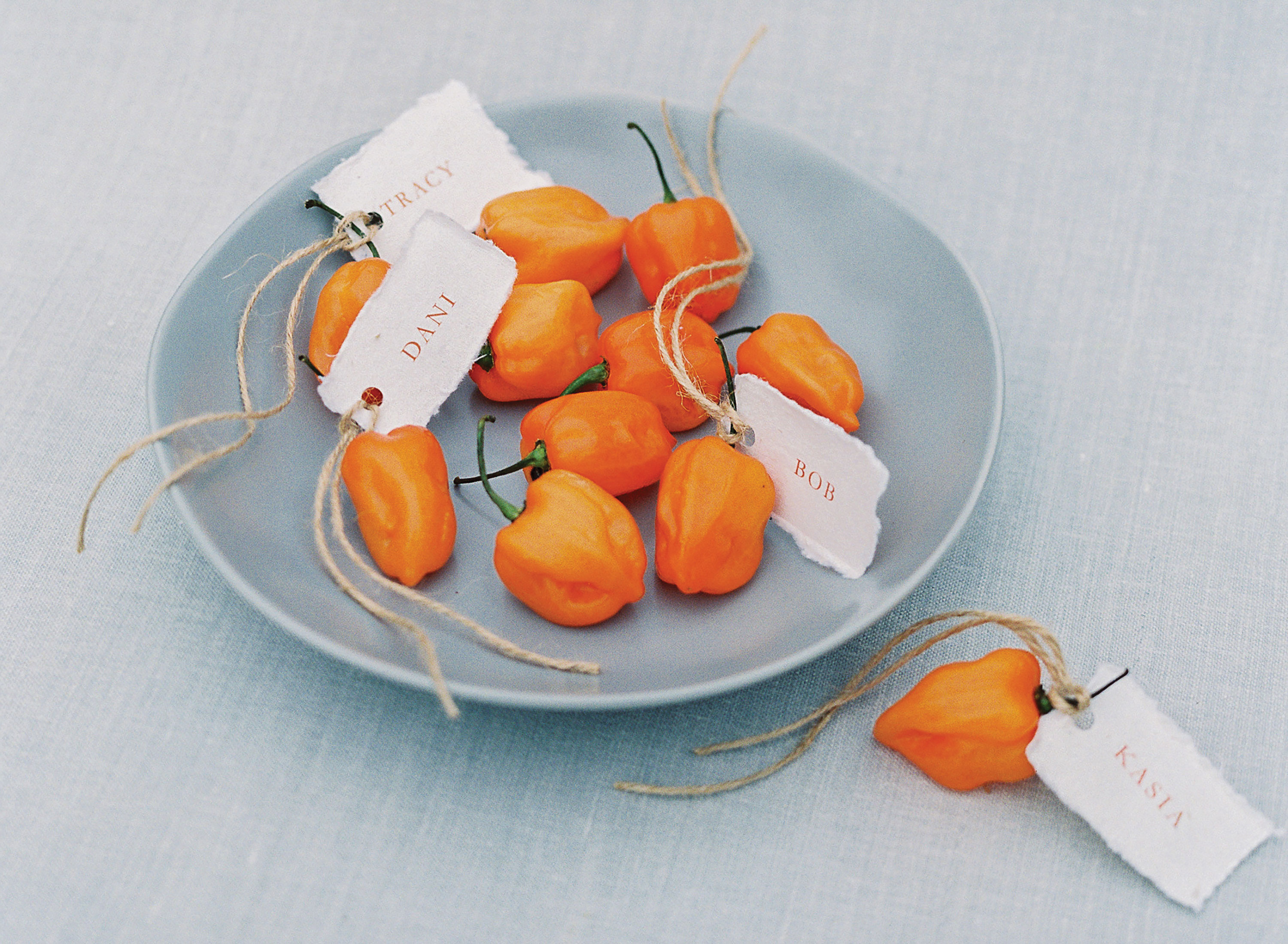 thanksgiving name cards place cards with orange mini peppers and twine