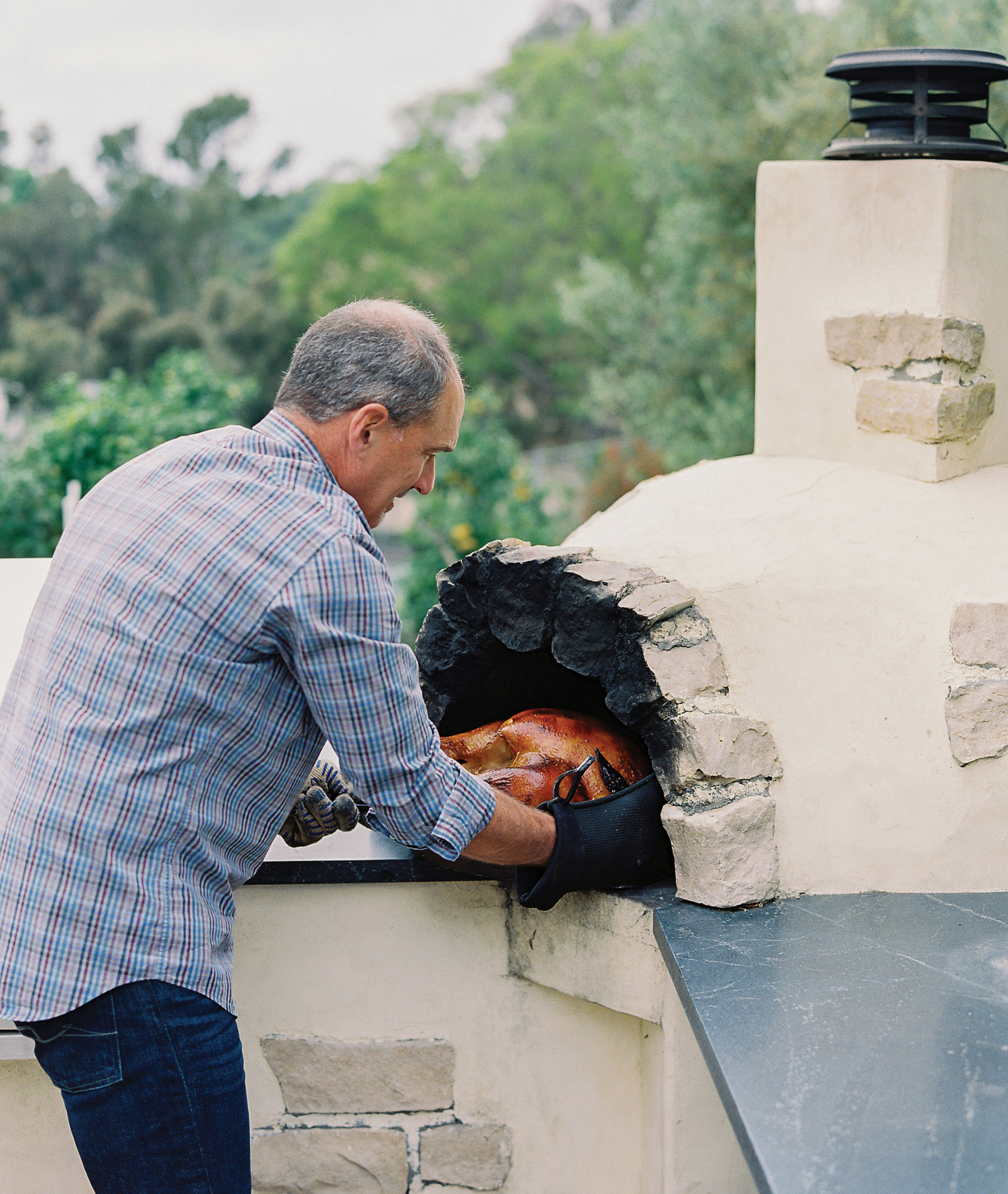 outdoor Thanksgiving wood fired pizza oven turkey